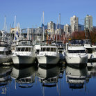 Picture - Yachts and Granville Island in Vancouver.