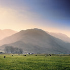 Picture - Field and rolling mountains in the Langdale Valley.