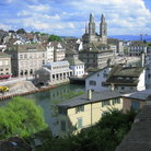 Picture - Panoramic view of Grossmunster (Great Minster) along river in Zurich.
