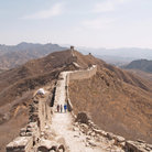Picture - Tourist walking along the Great Wall of China.
