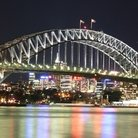 Picture - Sydney harbor bridge at night.