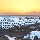 Picture - Sunset over the whitewashed homes of Haria on Lanzarote.