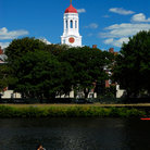 Picture - Red dome on white tower at Harvard University with the Charles River in the foreground.