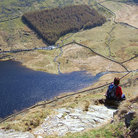 Picture - A hiker looking down on Haweswater.