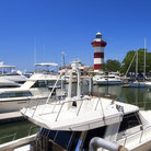 Picture - The red and white Harbor Town Lighthouse, also called the Hilton Head Lighthouse.
