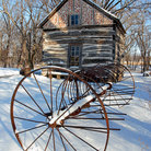 Picture - Palmer-Epard Cabin and old hay rake at Homestead National Monument of America.