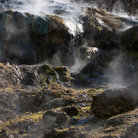 Picture - Steam rises from natural hot springs.