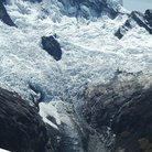 Picture - A glacier on a mountain peak with pool below in Huascarán National Park.