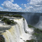 Picture - Water cascades over the rocks of Iguacu Falls.