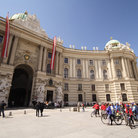 Picture - Exterior of Hofburg adorned with statues and carvings.