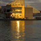 Picture - Golden sunlight reflecting off a building the Baltimore's Inner Harbor.