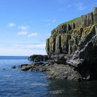 Picture - Cliff walls along the sea near Carsaig.