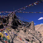 Picture - Tsemo Castle with prayer flags in Leh, Ladakh.