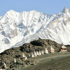 Picture - Stupas in front of the mountains at Ladakh, Kashmir.