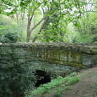 Picture - Old moss covered bridge at Jesmond Dene in Newcastle-upon-Tyne.
