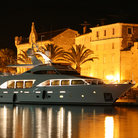 Picture - A boat in the harbour at night in Trogir.