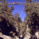 Picture - Suspension bridge across mountain river outside Kathmandu.