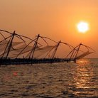 Picture - Sunset and fishing nets in Kerala.