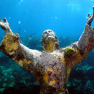 Picture - Statue of christ underwater in coral garden off Key Largo.