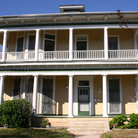 Picture - Victorian home with wrap-sround balcony in the King William historic district.