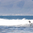 Picture - A surfer on a wave at Kleinmond.