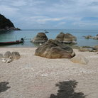 Picture - Rocks and boat on the beach at Koh Pha Ngan.