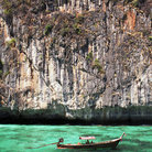 Picture - A long boat on the clear water at Koh Phi Phi.
