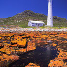 Picture - The shoreline in front of the lighthouse at Kommetjie.