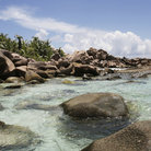 Picture - Beach and rocks on La Digue Island.