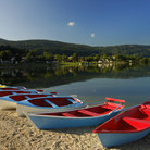 Picture - Colorful boats on the shore of the Lac de Joux.