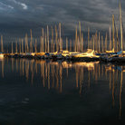 Picture - Sailboats in the sunset on Lake Geneva.