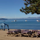 Picture - Picnic tables on a beach at Lake Tahoe.