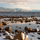 Picture - Snow covered rocks on the shore of Lake Tahoe.