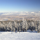 Picture - Skiers on the slopes above the Nevada desert, Lake Tahoe, Nevada.