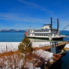 Picture - Cruise ship docked on the shore of Lake Tahoe.