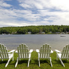 Picture - Ardirondack chairs on the shore of Lake Winnipesaukee.