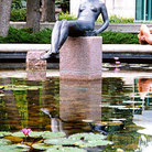 Picture - A statue sits in a lily pond in Leo Mol Garden at Assiniboine Park in Winnipeg.