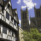Picture - Tudor building and the Lincoln Cathedral.