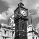 Picture - Clock tower in front of Victoria Station in London.