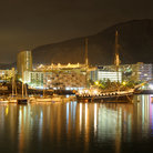Picture - The city lights of Los Cristianos reflecting on the water at night.