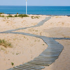 Picture - Winding boardwalk in the sand at Ludington, Michigan.