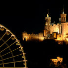 Picture - Ferris wheel in front of Notre-Dame de Fourviere in Lyon.