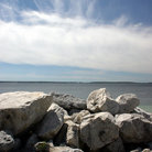 Picture - The rocky shoreline of Mackinac Island.