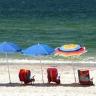 Picture - Beach umbrellas and chairs at Madeira Beach.