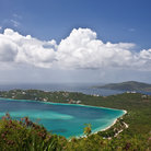 Picture - Distant view over the beach and blue waters of Magens Bay.
