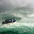 Picture - The Maid of the Mist tour boat in the turbulent waters below Niagara Falls.