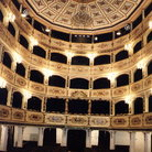 Picture - The sumptuous interior of the Manoel Theater in Valletta with gilded boxes and seats upholstered in green velvet.
