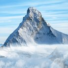 Picture - Peak of the Matterhorn over clouds.