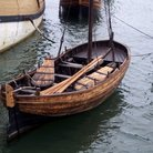 Picture - Vintage row boat, along the side of the Mayflower ship in Plymouth.
