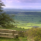 Picture - Bench looking out on the fields seen from Mendip Hills.